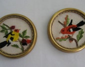 pair of vintage hand embroidered birds in frames