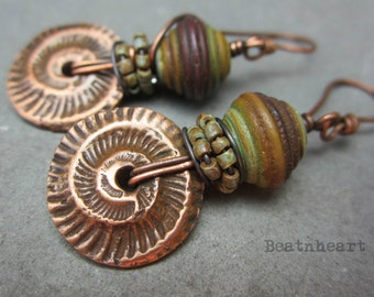 Why. artisan earrings boho rustic desert green brown taupe lamp work beads PMC copper ammonite discs