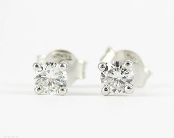 Classic Diamond Stud Earrings, 0.30 ctw Round Brilliant Cut Diamonds set in 18 Carat White Gold Four Claw Settings.