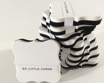 24 petite shaped giftcards in black and white