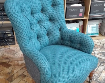 re-upholstered antique iron back chair