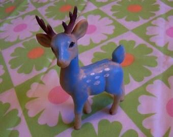 little blue rubber deer