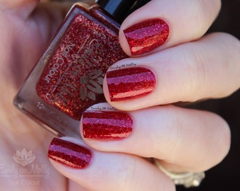 "Nail polish - ""Understatement""  gold holographic glitter in a dark red jelly base"