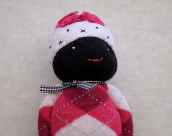Small Black Sock Doll dressed in Shades of Pink