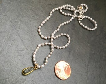Dainty Pearl Buddha Necklace knotted on silk