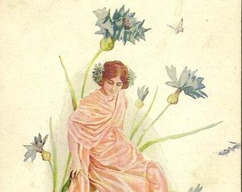 Elegant Pink Fairy Amidst Blue Bachelor Button Flowers 1909 Vintage Postcard – Feminine and Mystical Image