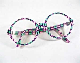 Mod pink and green circular eyeglasses. 1980s novelty eyeglass frames Art Craft holiday 320.