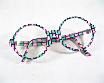 Mod pink and green circular eyeglasses. 1980s novelty eyeglass frames Art Craft holiday 320.