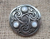 Mother of Pearl Celtic knotwork shield brooch - chunky pewter with triquetras and creamy white nacre