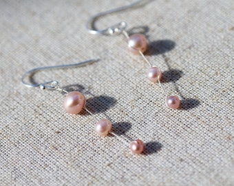 delicate pinky peach freshwater pearl drops by twinkle jewellery