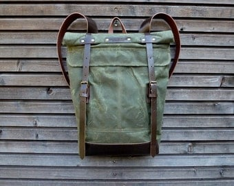 Waxed canvas rucksack / backpack with roll up top and vegetable leather shoulderstrap,handle and bottom  COLLECTION UNISEX