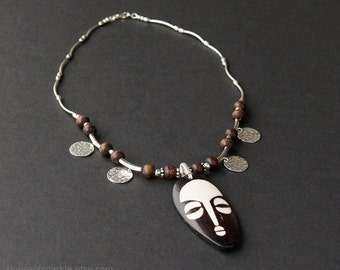 African tribal mask sterling silver necklace. African mask beaded necklace. Brown wood beaded necklace.