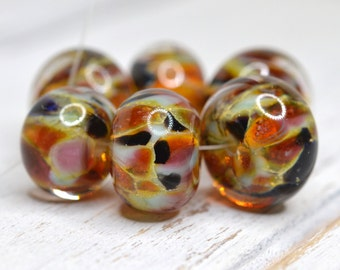 lamp work beads... SRA handmade, encased pink, amber, gold, cranberry, topaz and black set for making jewelry 31816-4