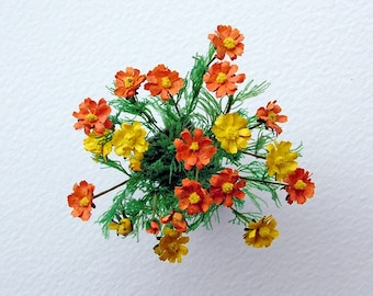 Vibrant cosmos flowers in a modern style black vase for the 12th, one inch scale dolls' house