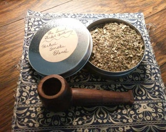 4 oz tin of hand mixed, tobacco free, herbal smoke blend and hand carved  cherry wood pipe.