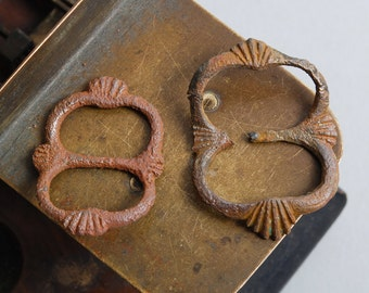 Set of 2 Antique small brass belt buckles. Primitive finding.