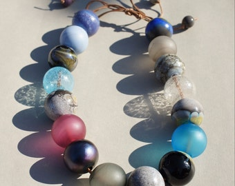 Handmade multi color  statement necklace with blown hollow glass beads by Flamejewels.