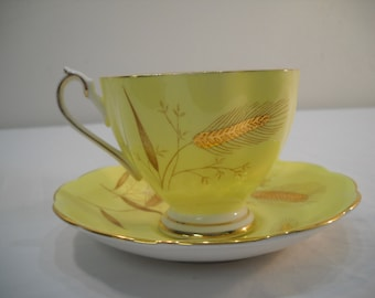 Vintage Queen Anne Bone China Yellow And Guilded Gold Teacup And Saucer