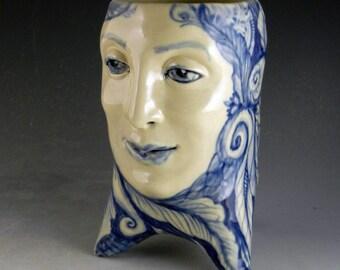 Blue and white 3 legged porcelain face vase