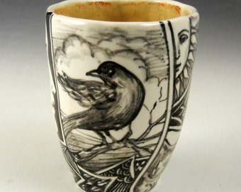 Magical story cup or tea bowl, black and white with faces, bird, jester and more