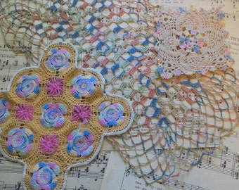 Pretty collection of three doilies made with soft colors