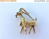 MOVING SALE Half Off Vintage Gold Tone Metal Goat Brooch with Green Rhinestone Eyes