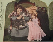 Stereograph card for Stereoscope 1900s Colored Picture Atlas View Company Girl Cat Dog