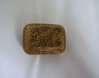 Small brass box with flower decoration on the top