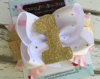 First Birthday Bow - Pink and Gold 1st Birthday Bow - Glittery Gold bow with shimmering 1 in the center EXCLUSIVE to Darling Little Bow Shop