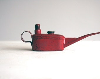 working vintage small red english oil can