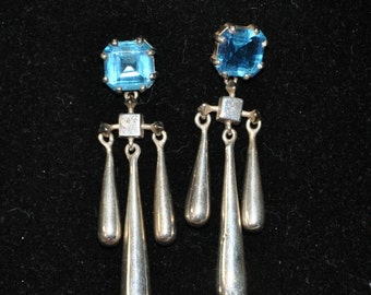 Stunning Sterling silver rain drop earrings with Topaz stone