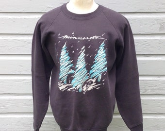 Distressed 1980's Minnesota pine trees sweatshirt, fits like a roomy medium