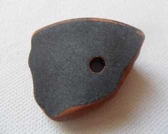 Unusual black & terracotta sea pottery with a hole - Lovely English beach find piece from Lancashire, UK