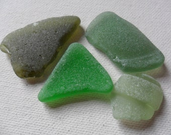4 green sea glass shards - Lovely beach find pieces. Imperfect but pretty.