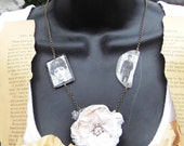 SALE  was 25.00 now 10.00 assemblage flower necklace with reversible charms.