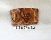 Willow creek jasper cabochon.  shades of brown. 16 x 27 x 5.2