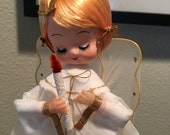 1960s Japan Musical Christmas angel with blond hair holding a candle doll