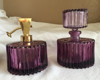 Irice perfume bottles purple glass PAIR vintage vanity ribbed sides label rare purple color one with atomizer gear and one with stopper