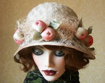 Beautiful cream racello straw cloche with silk apples