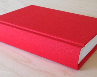 Bright tangerine journal or sketchbook with blank pages