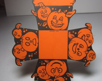 Vintage unused die cut 1920's Dennison halloween party favor nut cup colorful bright orange graphics of various jack o'lanterns