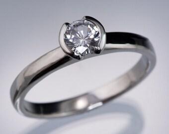 Round White Sapphire Half Bezel Tulip Solitaire Engagement Ring in Palladium, White, Rose & Yellow Gold, Platinum, Diamond Alternative