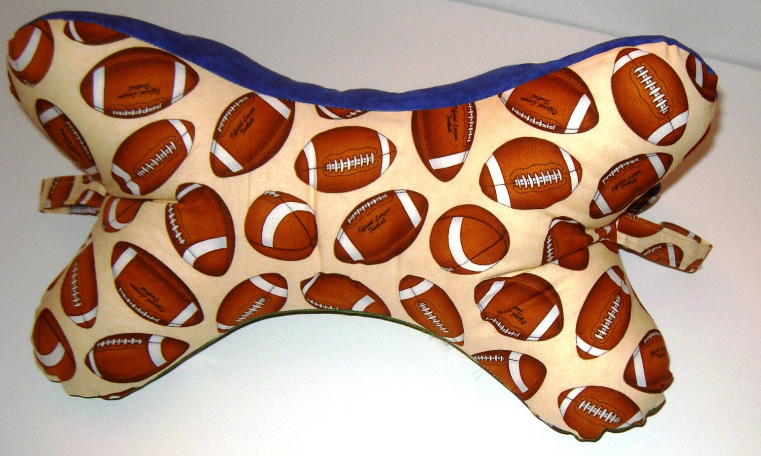 Dog Bone Shaped Neck Pillow With Handles Football Theme