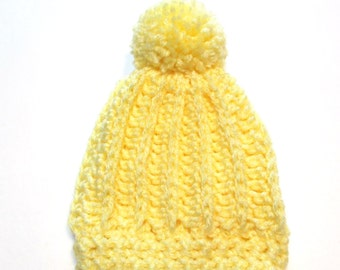 Newborn winter hat with pom pom.  Pastel yellow baby hat for winter.  Textured beanie with pom pom for newborn to 3 month baby shower gift.