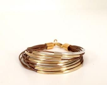 Buy one and get 2nd leather bracelet for 50% off: Metallic bronze leather bracelet with silver and gokd tube accents