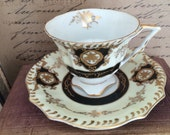 Vintage Gilded Tea Cup and Saucer Black and Gold With Pale Yellow Band Possibly Lefton No Backmark