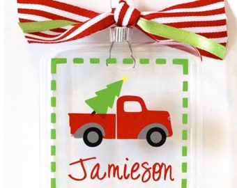 Personalized Ornament with Red truck carrying a Christmas tree