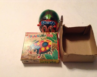 vintage mechanical flapping lady bug toy with original box