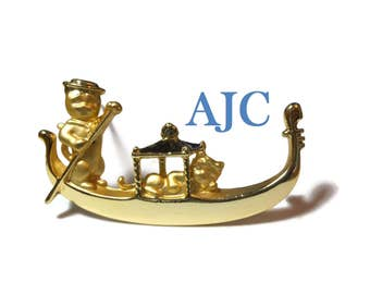 AJC cats in gondola brooch, gondolier with oar pin,  in gold tone satin and gloss finish signed