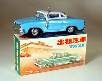 Vintage Tin Friction Taxi Blue MF713 from Red China, dating from the mid 70's